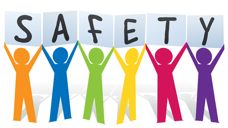 Color paper people cutout holding letters that spell SAFETY