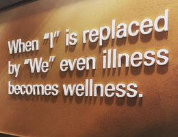 Banner that says when I is replaced by we even illness becomes wellness